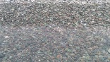 Pebbles only- no sand at this beach! Terrace of the Three Immortals (Sanxiatai)- along Highway 11
