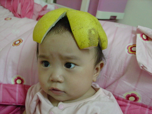 Baby with pomelo on head to celebrate Mid Autumn Festival