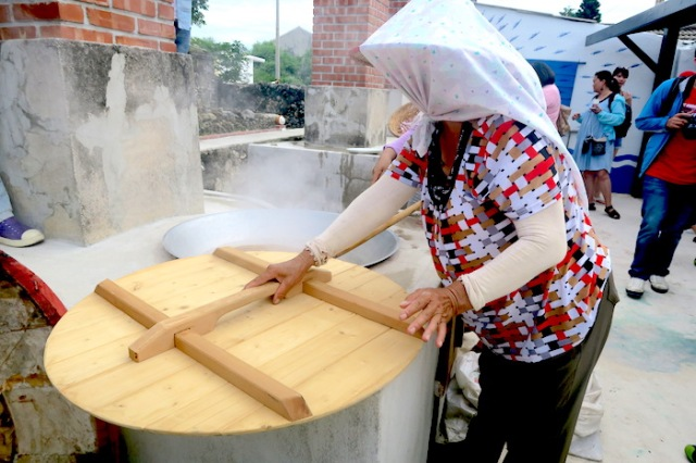Woman cooking with Fu Ji Stove in Nanliao Community