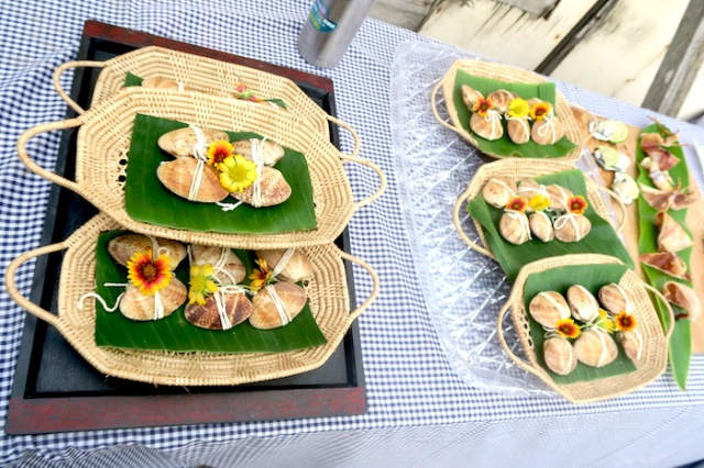 Trays with baskets of shells filled with a rice mixture made by the Nanliao Community in Penghu