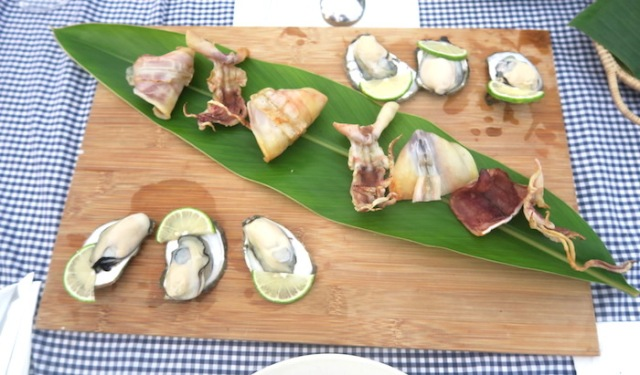 A platter of dried squid and six oysters