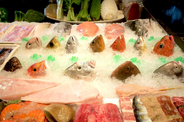 Fish head and seafood display at Fulou Restaurant