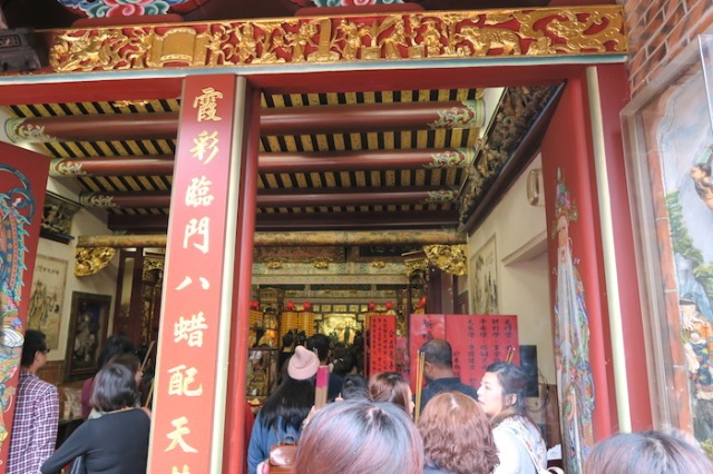 Lining up to pray at Taipei Xia Hai City God Temple