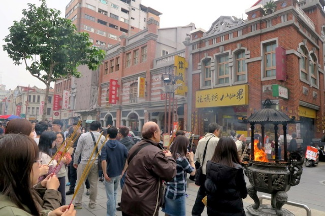 People praying in front of the Xia Hai City God Temple in Tapei